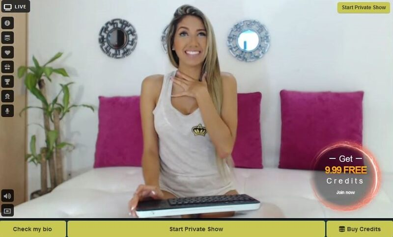 Sexy bronzed bodied blonde smiles for the camera on LivePrivates.com