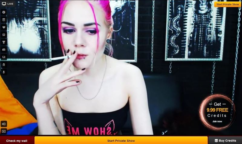 Pink haired model smoking a cigarette